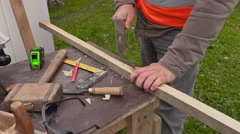 Carpenter with hammer and nail at the working table Arkistovideo