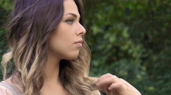 Impatient young woman waiting for someone is touching her hair Stock Footage