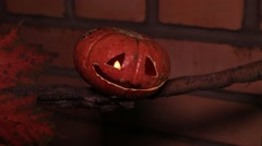 Jack-o-lantern on a dry branch Stock Footage