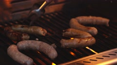 Grilling sausages on barbecue grill. Selective focus Stock Footage