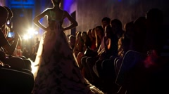 Model in a luxurious ball gown with spotlights Stock Footage