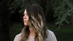 Beautiful young woman waiting for someone. impatient woman looking around her Stock Footage