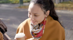 Young woman in the park talking to your child Stock Footage