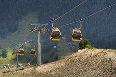 Cable car gondola in Alps mountains near Livigno lake Italy Kuvituskuvat