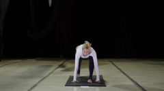 Young woman doing yoga tricks on the mat Stock Footage