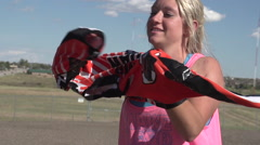 A young woman bmx rider putting on riding shirt. Stock Footage