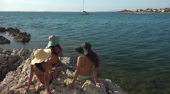 Women relaxing by the sea, enjoying their vacation Stock Footage