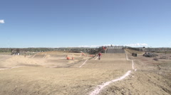 A young woman bmx rider riding on dirt track. Stock Footage