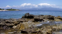 Orizontal panorama with waves that burst of rocky shore and in the distance y Stock Footage