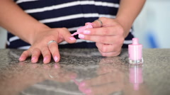 Woman applying nail polish Stock Footage