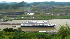 Cruise ship (Hollandamerica cruise Line) in Panama Canal Lock in a cloudy day Stock Footage