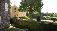 Slater Mill on the banks of the Blackstone River in Pawtucket Stock Footage