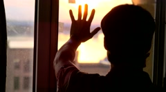 Man in dark room opens curtains on window to the sun and try to touch the Stock Footage