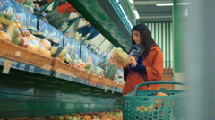 Happy woman grocery shopping at the supermarket Stock Footage