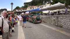 Entertainment train that brings tourists to the sunny seaside resort and a gr Stock Footage