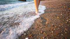 Female Walking Barefoot on Sea Shore at Sunset. Closeup. HD, 1920x1080 Stock Footage