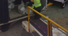 Worker Loads Bags of Mail Onto Commercial Flight at Airport Stock Footage