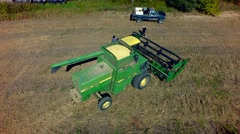 Harvesting of soybean field with combine Stock Footage