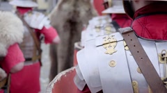 Roman legionaries column dressed in armor that marches and that stops Stock Footage