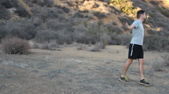 A young man trail running. Stock Footage