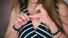 Woman clear the cuticle Stock Footage