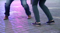 Dancer's legs perform lindy hop dance step on the city's square pavement. Street Stock Footage