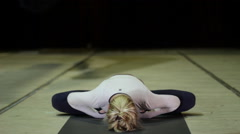 A young woman practicing yoga in a lotus position Stock Footage