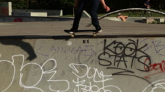 A young skateboarder skating in the bowl of a skate park. Stock Footage
