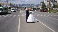 The bride and groom are standing on the road Stock Footage