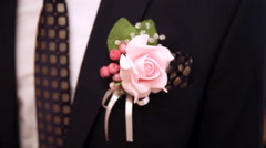 Boutonniere on his jacket the groom Stock Footage