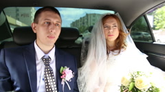 The bride and groom traveling in the car Stock Footage