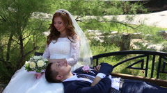 Bride and groom on the bench Stock Footage