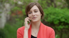 Elegant and classy woman  talking seriously on the phone Stock Footage