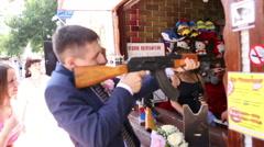 Groom shoots a machine gun Stock Footage