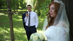Bride and groom in forest Stock Footage