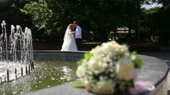 Bride and groom dancing at the fountain Stock Footage