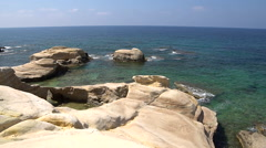 White beach. Mediterranean Sea. Sea landscape of Cyprus with a rocky shore. Stock Footage