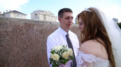 The groom passionately kisses the bride Stock Footage