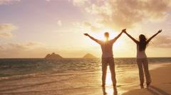 Enjoyment - free happy people woman and man enjoying sunset Stock Footage