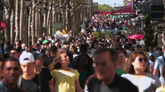 People walking in slow motion on Champs Elysee boulevard in Paris Stock Footage