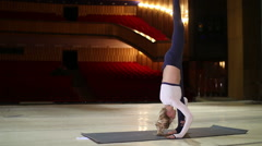 Young sexy woman practicing yoga on stage Stock Footage