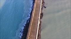 Aerial birds eye view of Newhaven breakwater Stock Footage