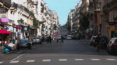 Street canyon in Paris - traffic in slow motion Stock Footage