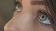 Fresh and attractive teenager with blue eyes: closeup portrait on eyes Stock Footage