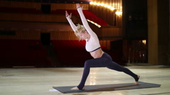 Woman doing gymnastic exercise on stage Stock Footage