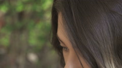 Beautiful woman with green-blue eyes looking up: closeup portrait  Stock Footage