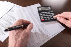 Male hand using calculator Stock Photos