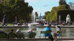 People walking and relaxing in the Tuileries gardens in Paris Stock Footage