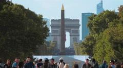 Obelisk and Arc de Triomphe in Paris - long distance slow motion shot Stock Footage