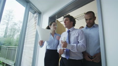 4K Company boss walking through office, giving instructions to his staff Stock Footage